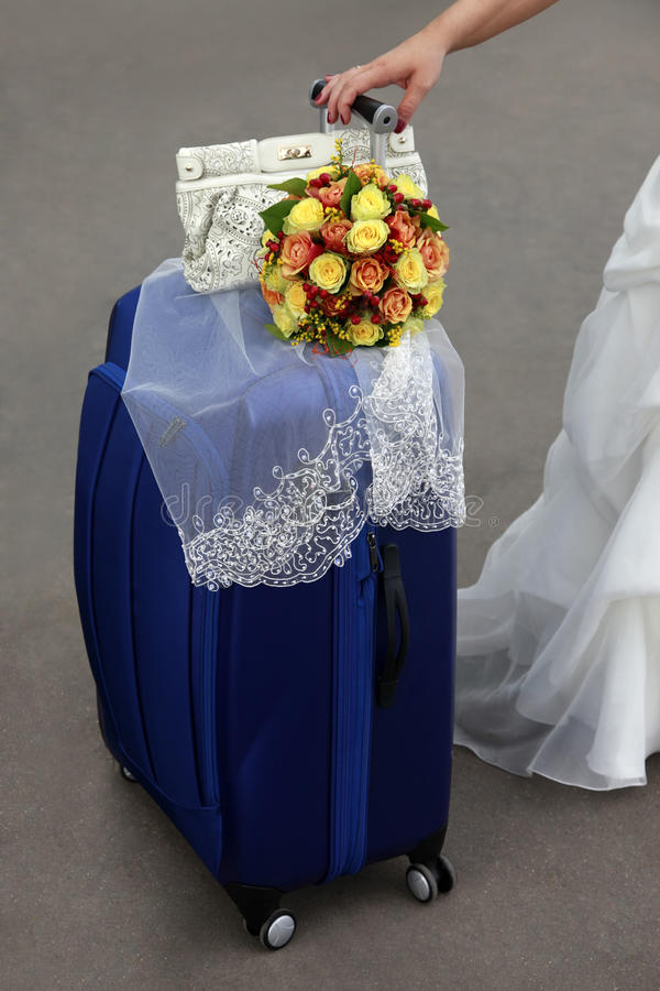 Bride with blue suitcase stock images