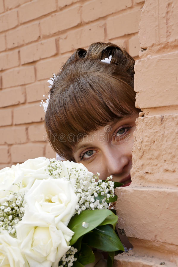 Bride with bouquet. The bride with a wedding bouquet of roses stock image