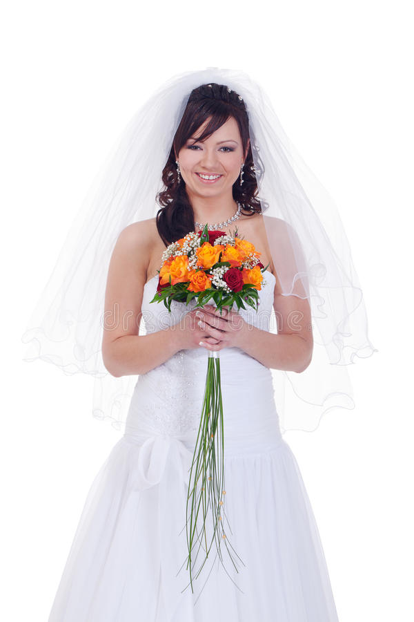 Bride with bouquet. Bride holding bouquet with roses royalty free stock images