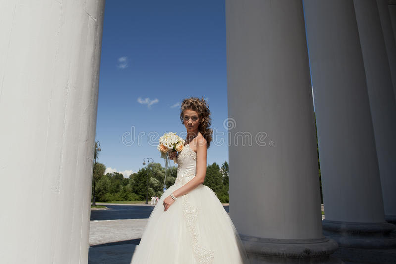 Download The Bride With A Bouquet At Columns. Stock Photo - Image: 20950858