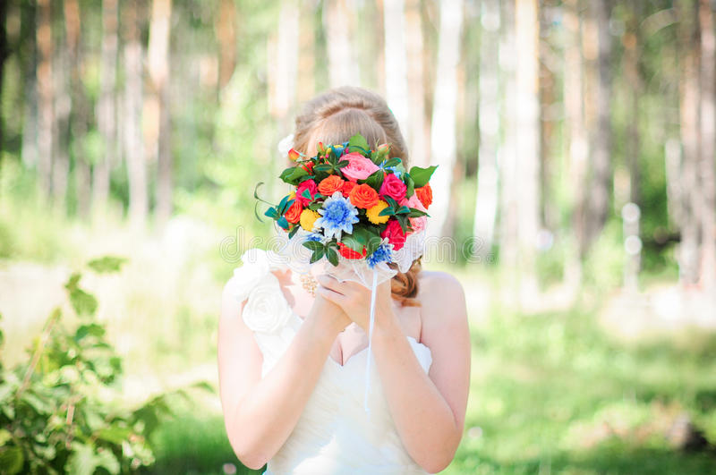 Bride with a bouquet of flowers stock photos