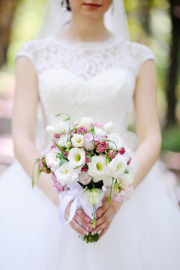 Bride with a bouquet in hands stock images