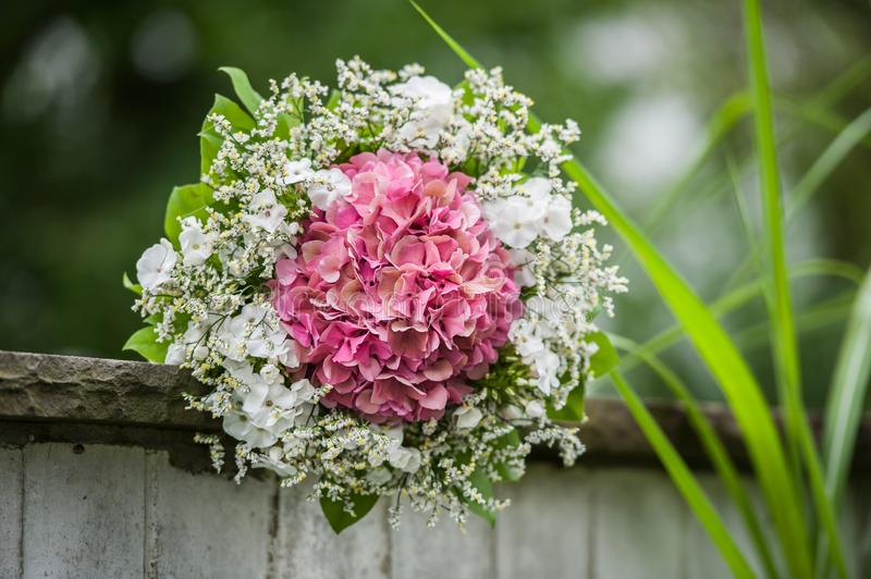 Bride bouquet on stone wall royalty free stock images