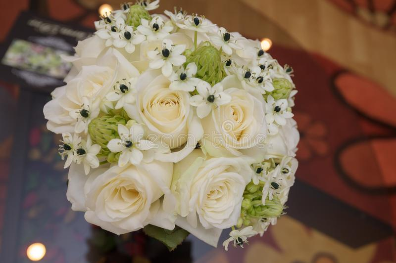Bride bouquet with white roses stock photo