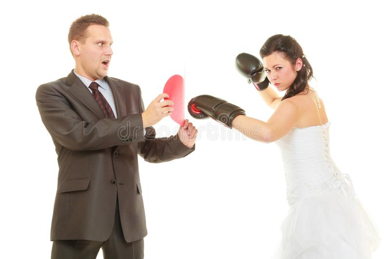 Bride boxing her groom on wedding royalty free stock photography