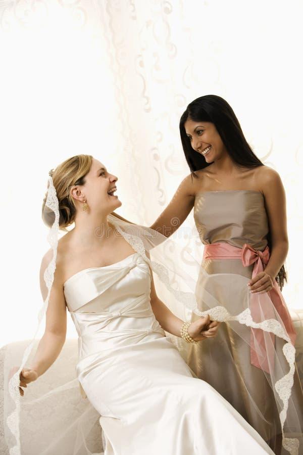 Bride and bridesmaid stock photos
