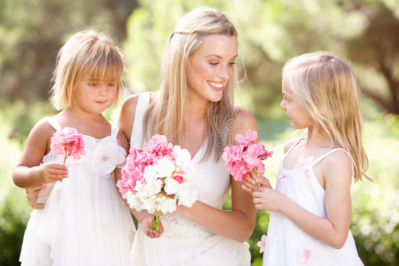 Bride With Bridesmaids Outdoors At Wedding. Smiling stock photography