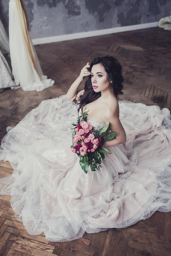 Bride brunette with flowers stock photos