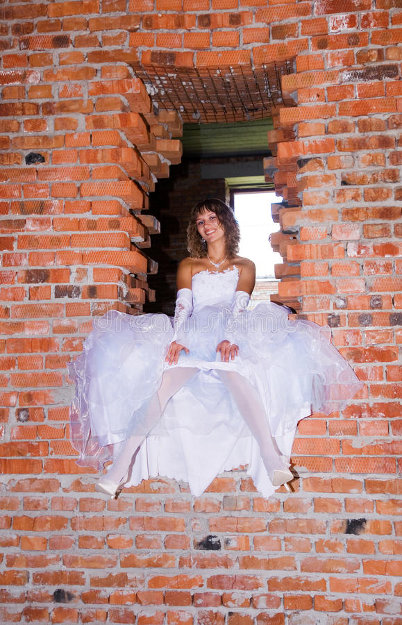 Bride in building site royalty free stock image