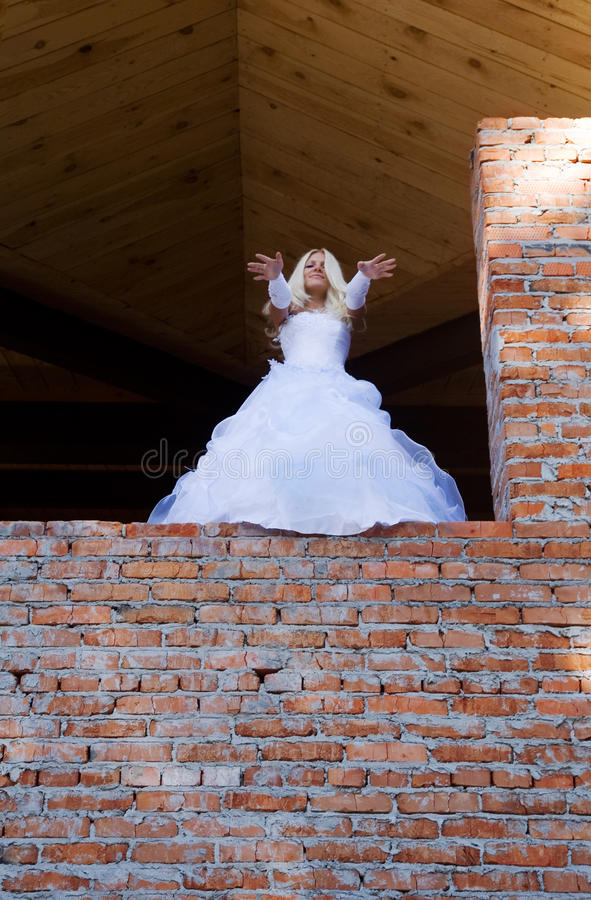 Bride in building site stock image