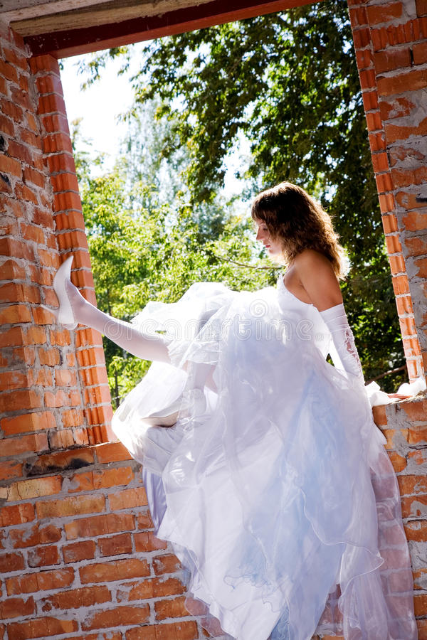 Bride in building site royalty free stock photo
