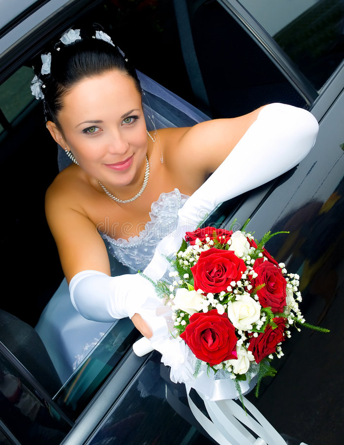 Bride in the car royalty free stock photos