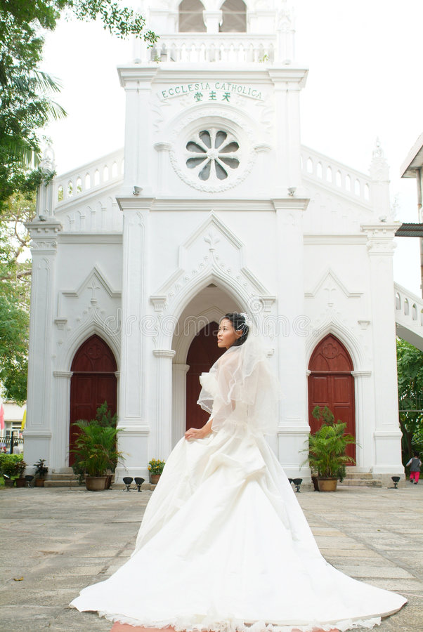 Bride at church door stock images