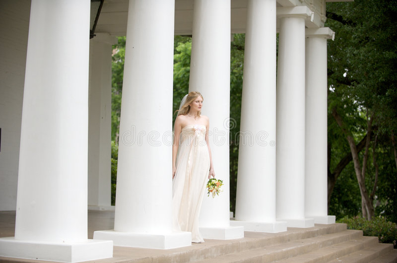 Bride on a columned porch stock photo