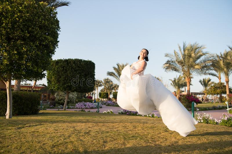 Bride concept. Bride hover in air. Bride in white wedding dress. Bride celebrate her special day. What a lovely dress stock image