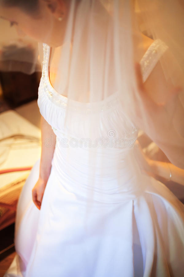 Bride dress. Bride putting her white dress on stock photo