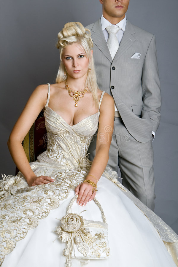 Bride in dress. Beautiful bride looks very nice with a man