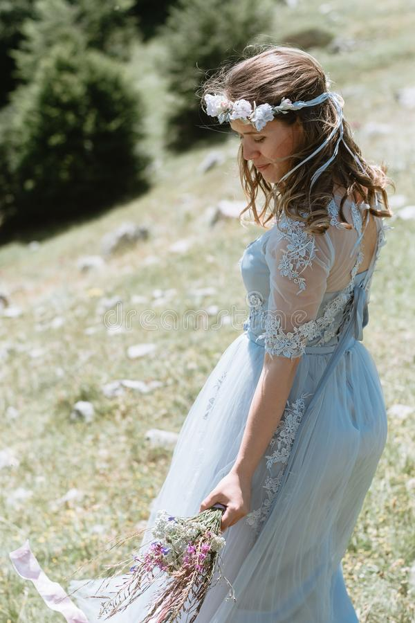 Bride in a dress walking along the road against the background o royalty free stock image