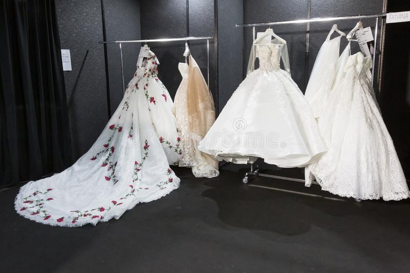 Bride dresses in the backstage at Si Sposaitalia 2019. MILAN, ITALY - APRIL 7: Bride dresses in the backstage at Si Sposaitalia just before Amelia Casablanca stock photography