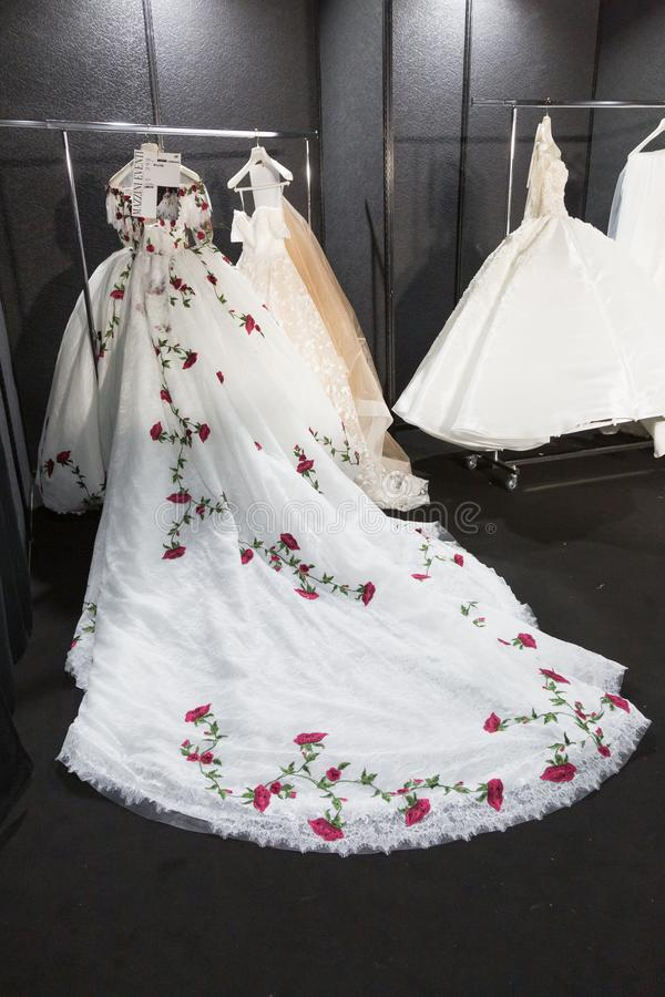 Bride dresses in the backstage at Si Sposaitalia 2019. MILAN, ITALY - APRIL 7: Bride dresses in the backstage at Si Sposaitalia just before Amelia Casablanca stock images