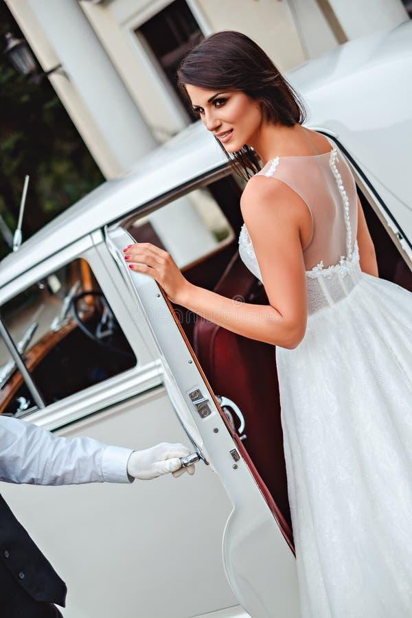 Bride entering classic car royalty free stock image
