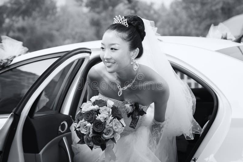 Bride exiting wedding car limo