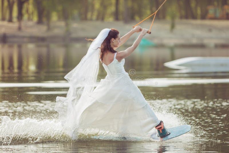 Bride is an extreme sportswoman. stock photo