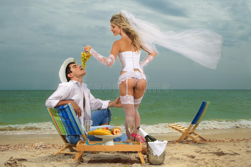Download Bride Feeding Her Groom With Grapes Stock Photo - Image: 27625232