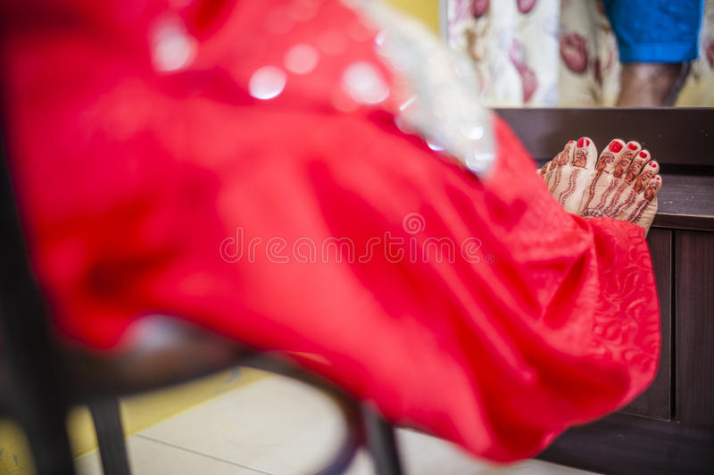 Bride feet wearing henna. Punjabi bride's feet, fully decorated with henna decoration for her wedding day stock photography
