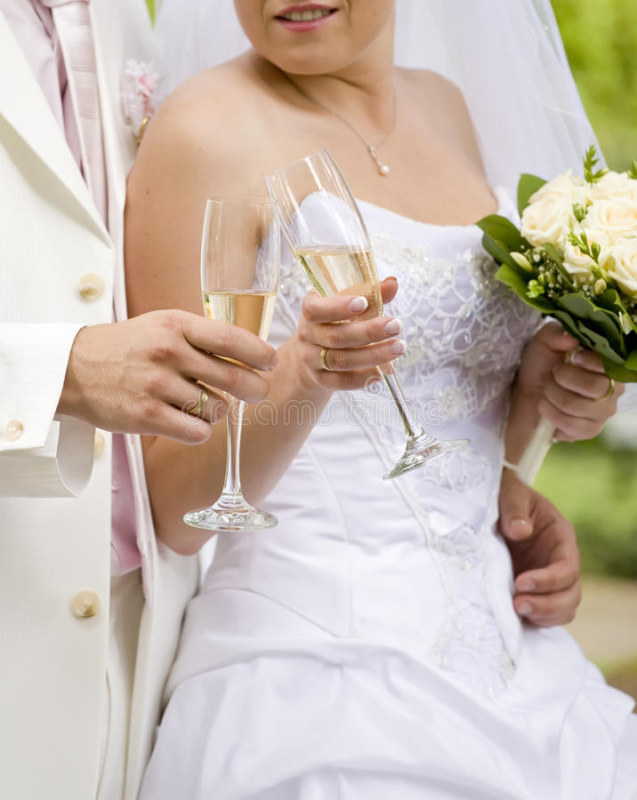 Bride And Fiance Clink Glasses Royalty Free Stock Photography