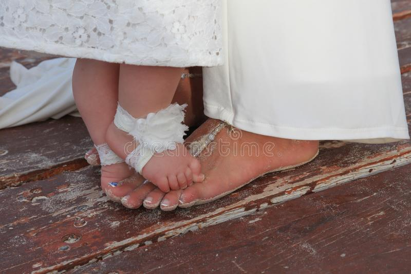 Bride and flower girl toes stock photo