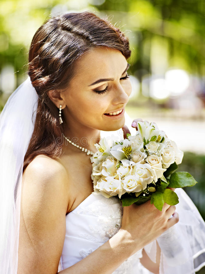 Download Bride with flower outdoor. stock photo. Image of happiness - 34069912