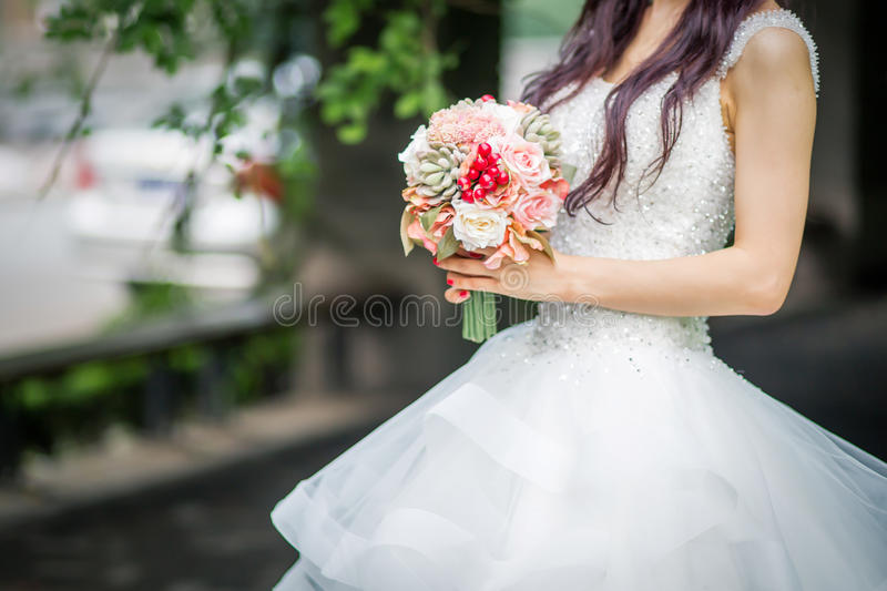 Bride. The bride of flowers in hand royalty free stock image