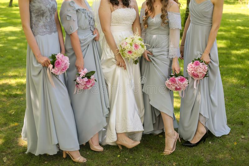 Bride with flowers and maids royalty free stock photography