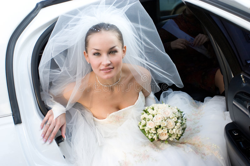 Download Bride With Flowers In The White Car Stock Photo - Image: 4870302
