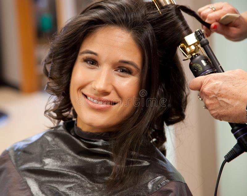 Bride getting hair done on wedding day royalty free stock image