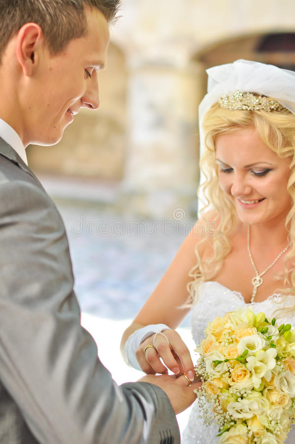 Download Bride giving ring to groom stock photo. Image of jewelry - 26501690