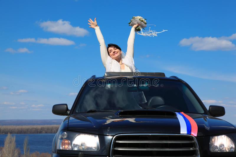 Bride is glad standing in car royalty free stock photos