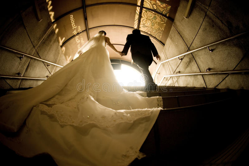 Bride and groom. Outdoor portrait at tunnel stair
