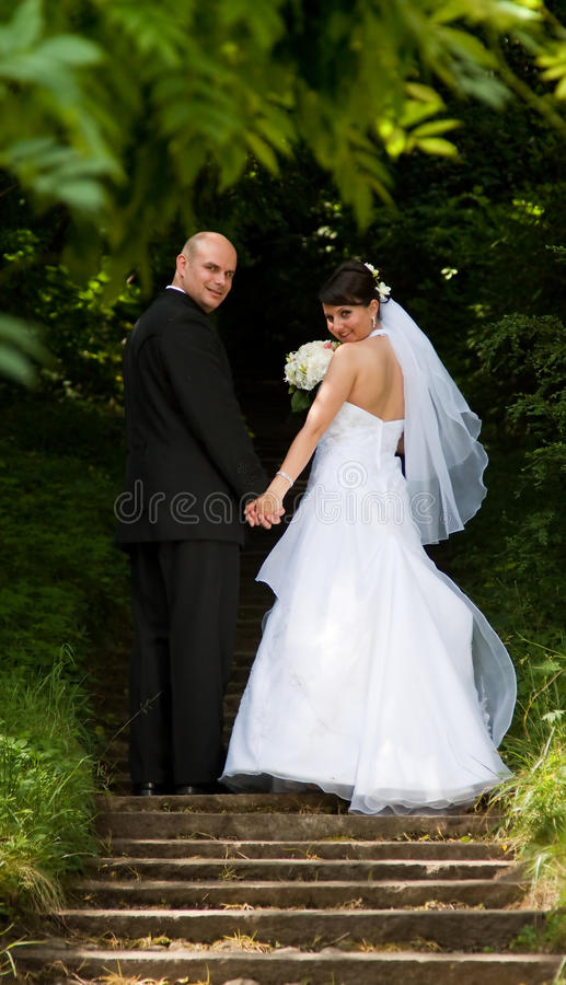 Bride and groom. Walking in park stock image