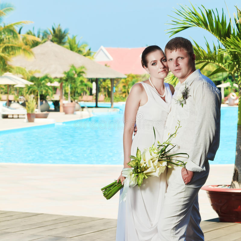 Download Bride and groom stock photo. Image of newlyweds, flowers - 19346786