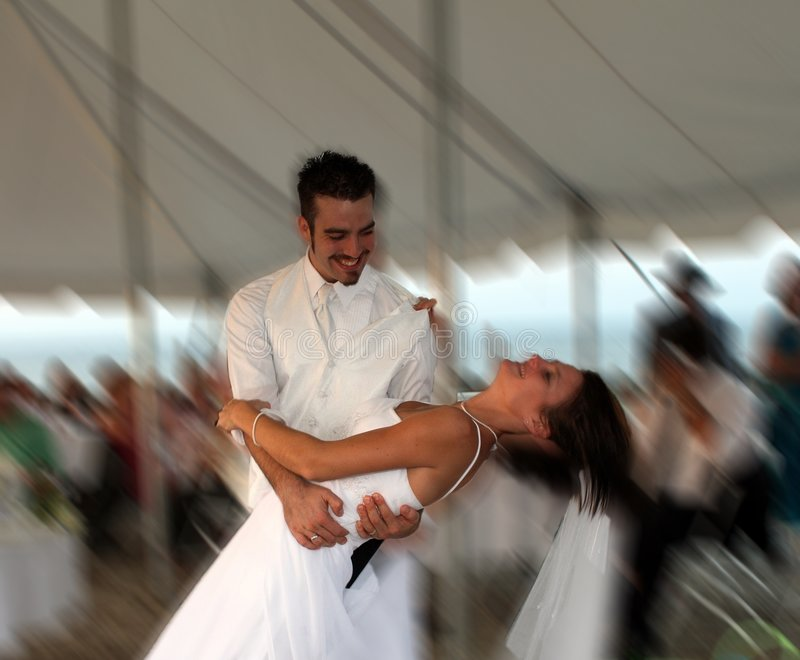 Bride and Groom. The bride and groom having fun after the ceremony. The feeling of motion is captured in the photo