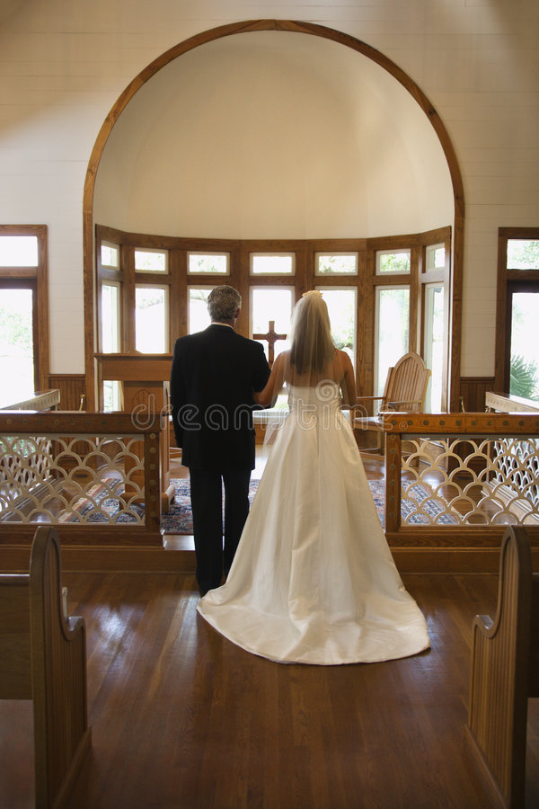 Bride and groom at alter. royalty free stock photos
