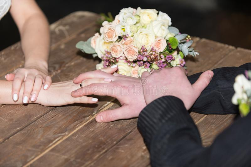 Bride and groom armwrestling. Ukreins royalty free stock image