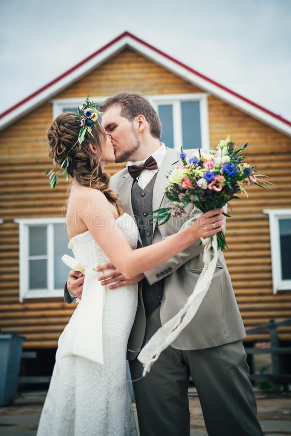 Bride and groom in the background of the house stock photo