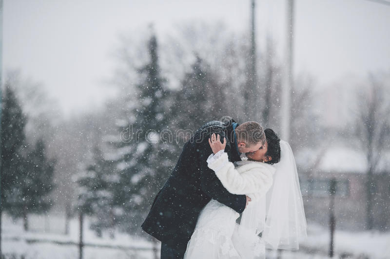 Bride and groom on the background of a winter city royalty free stock photo