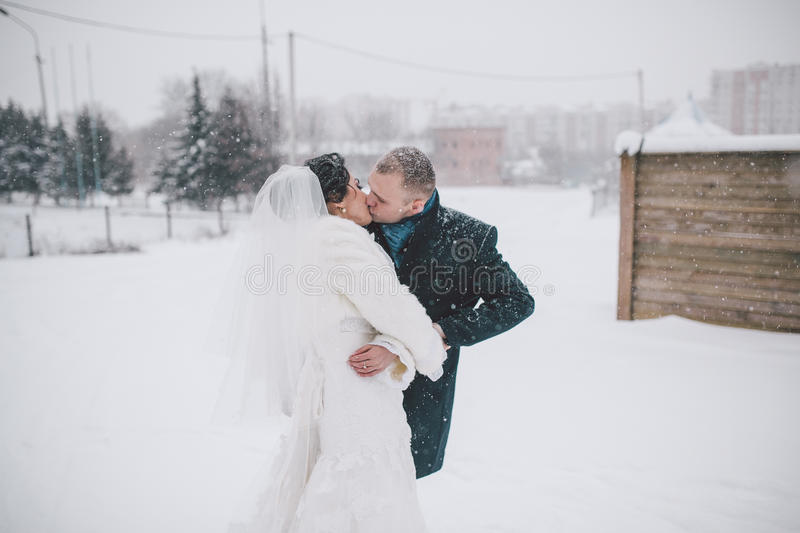 Bride and groom on the background of a winter city stock images