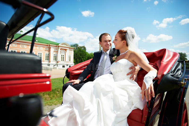 Download Bride And Groom In Beautiful Carriage Stock Image - Image of outdoors, love: 26520749