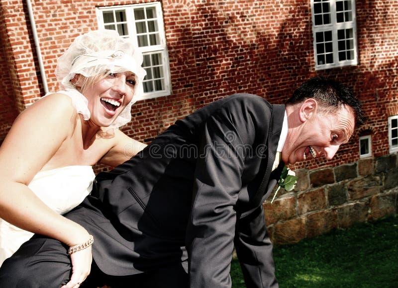 Bride and groom on bridge stock photo