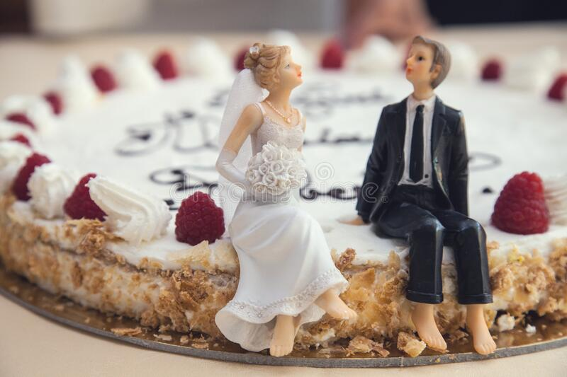 Bride and groom on cake stock photography